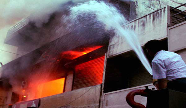 Two dead, several feared trapped in hospital fire